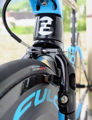 The front brake is easy to access and forms a non-structural leading edge to the stepped fork. There are rubber covers for the holes in the brake arm to keep it smooth