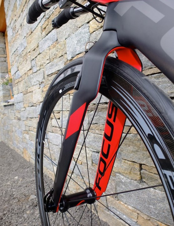 The fork has a wide stance to reduce drag from air passing over the wheel