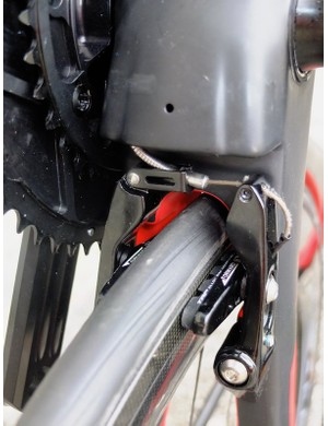 The TRP rear V brake is mounted under the chainstays behind a bottom bracket cowl