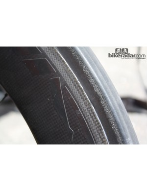 Katusha get around the UCI rule barring use of Mavic's detachable fairings on CX01 wheel technology by filling the channel with a mastic paste bought from DIY shops