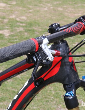 A 720mm-wide carbon bar steers the Camber