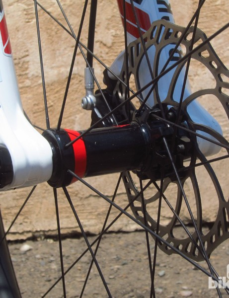 Specialized has finally relented, equipping the new Epic with 15mm thru-axle dropouts up front