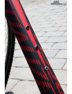 Three rivnuts are included on the down tube of Specialized's 2014 Stumpjumper carbon hardtail frame, for use with the new SWAT storage system