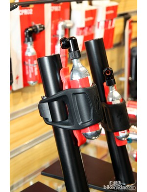 The Specialized Air Tool CO2 Mini Kit pairs a CO2 cartridge, inflator head, and tire lever into an all-in-one form that conveniently straps to your seatpost