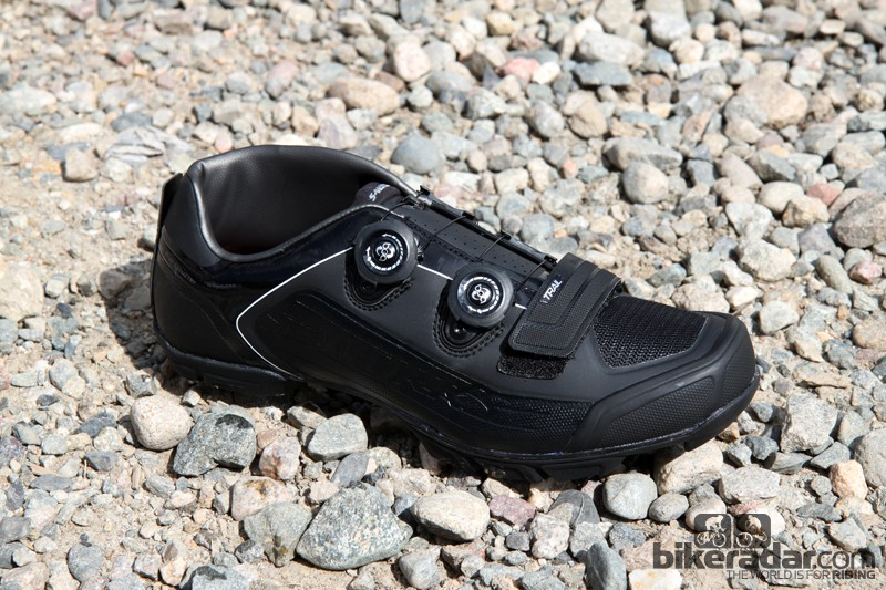 The new Specialized S-Works Trail shoes pair a super stiff, full length carbon fiber sole with a thermobonded upper. Extra forefoot volume lends a little extra room on landings, the toe box is armored with hard plastic, and the inner side is raised to protect your ankle