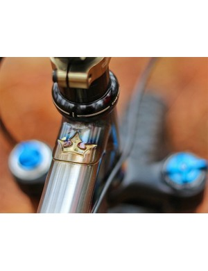 The top tube gusset boasts neat CNC detailing, complemented nicely by the clear coat finish