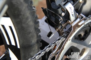 The lower link is also forged from aluminum, and has a small port for the front derailleur cable