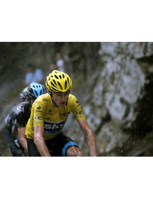 Chris Froome climbs La Croix Fry pass in pouring rain during the nineteenth stage of the Tour de France