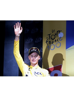 Chris Froome (Team Sky) celebrates on the podium after stage 20 of the Tour de France, where he had all but secured the final yellow jersey