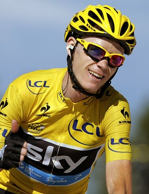 Christopher Froome of Britain, wearing the overall leader's yellow jersey, flashes a thumbs up and a big smile as crosses the finish of the 20th stage of the Tour de France