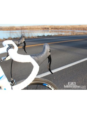 Campagnolo's hoods are superbly comfortable but the thumb shifters are off-putting to many