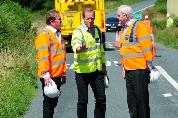 Gary Verity from Welcome to Yorkshire and John Weighell of North Yorkshire Council show Tour de France race director Christian Prudhomme developments for the 2014 grand depart