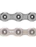 The original XX1 chain had a bit of material removed from the outer plates. The new PC-XX1 chain (top) does away with the cutouts