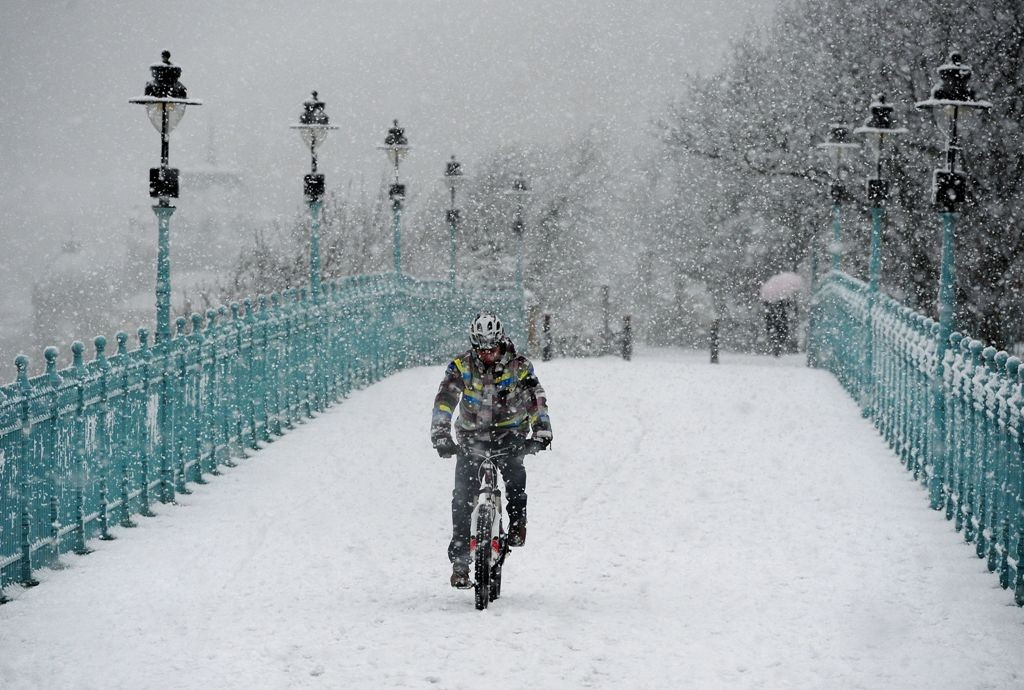 A rider braves snow in Scarborough in January 2013