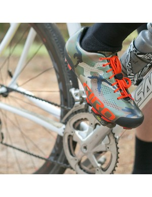 An elastic strap keeps the Empire mountain bike shoe's laces in place