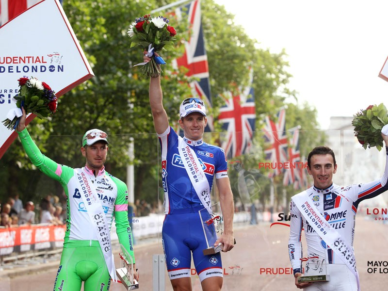 France's Arnaud Démare (centre) celebrates winning the Prudential RideLondon-Surrey Classic, with Italy's Sacha Modolo in second and France's Yannick Martinez in third