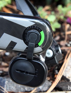The Garmin Vector pod contains a replaceable battery and ANT+ wireless transmitter. A small plastic-covered ribbon cable connects the pod to the spindle