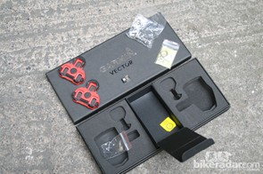 The Vector box includes cleats, bolts, washers, a USB firmware upgrader and an instruction booklet