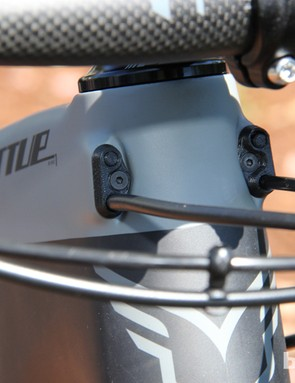 Both carbon bikes in the Virtue Nine series have internal cable routing through ports on either side of the head tube