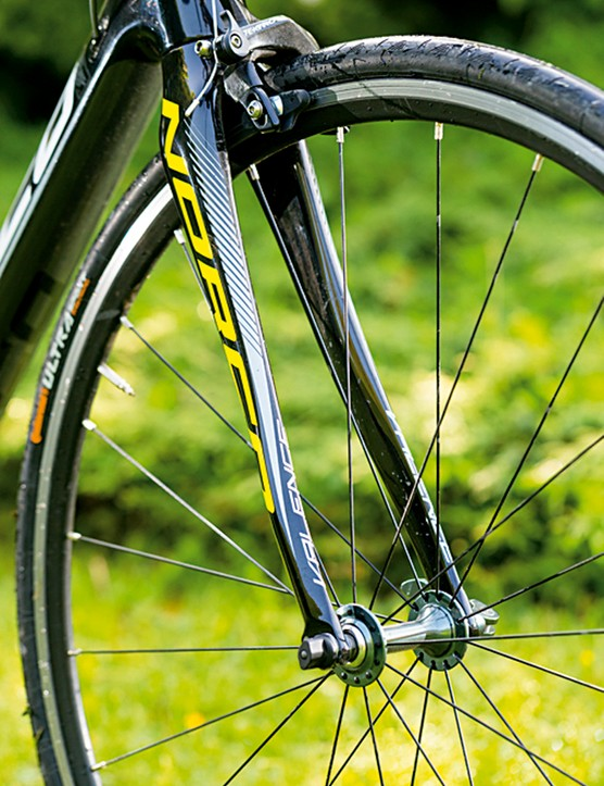 The Norco Valence Carbon's full-carbon fork is designed to be laterally stiff but vertically compliant. Mudguard eyelets add versatility
