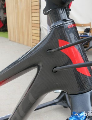 The Devinci Troy has internal cable routing through ports on either side of the head tube