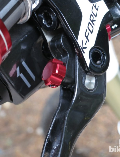The red dial behind the brake lever adjusts the reach of the FSA K-Force disc brake