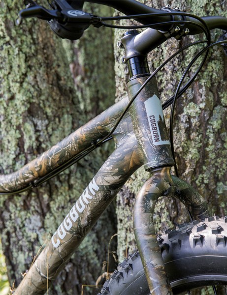 The Cogburn CB4 features 3.8in tires and allowances for a rack to carry a rifle, hunting bow, or fishing rod, along with cages for water or fuel bottles