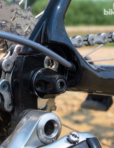 The rear derailleur cable is routed through the chain stay for a clean look on the Devinci Leo SL