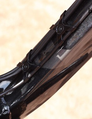 Neat cable guides double up as bottle cage mounts on the Nukeproof Mega TR 275