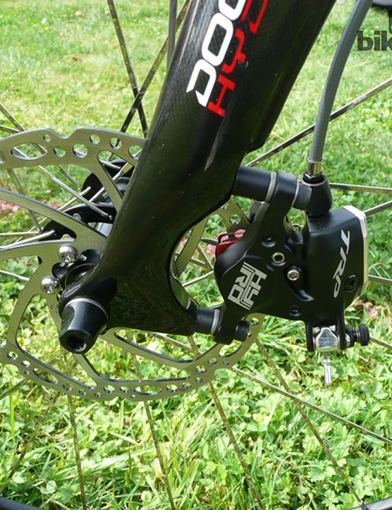 A closeup of the TRP HY/RD 160mm hydraulic disc brake on the Pinarello Dogma 65.1 Think 2