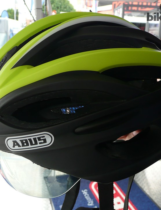 The Abus In-Vizz performance race helmet has an integrated visor that can be slipped down when the sum comes out