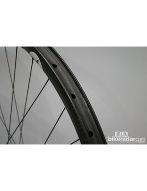 The AX Lightness SRT-29 wheelset uses a large and round bead profile to avoid snakebite punctures