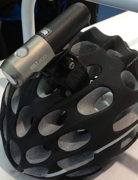 The lightweight CatEye Volt 300 can be mounted on a helmet. The black battery pack can be unscrewed and recharged on a handy USB cradle