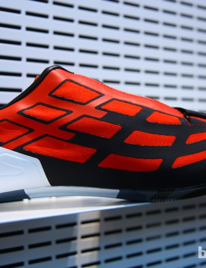 Pearl Izumi uses technology borrowed from its running shoe division to create a thin, seamless, mesh upper