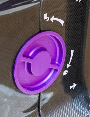 Custom latches are machined from aluminum and anodized to match the bike inside the custom Fairwheel Bikes travel case