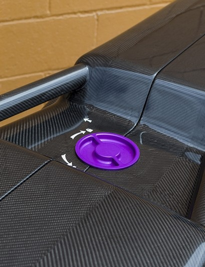 Sturdy grab handles are integrated into the carbon structure itself