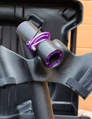 The custom carbon fiber cradle straps to the down tube and seat tube, not only suspending the bike in the interior of the case but also acting as a workstand for easier assembly and disassembly