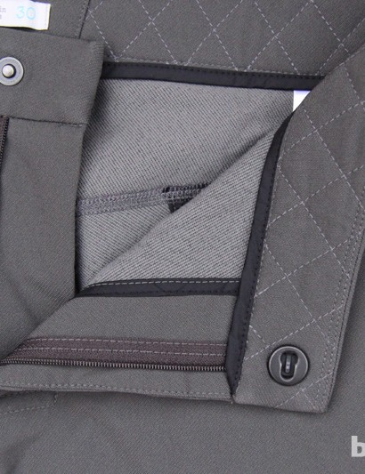 The Soft Shell A/M Short uses a sliding closure for a secure fit