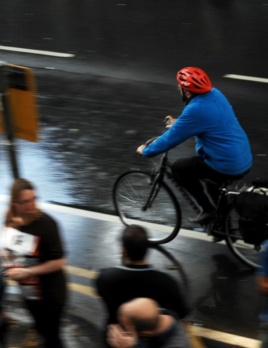 A man cycles to work