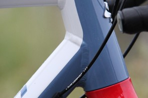 The frame has internal routing through ports on either side of the downtube for the front and rear derailleur cables