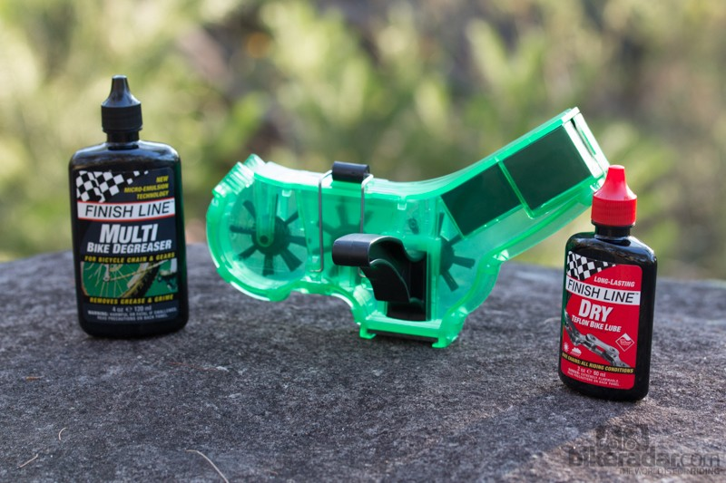 The Finish Line Shop Quality Chain Cleaner kit includes a chain cleaner, degreaser and dry lube