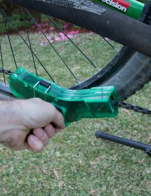 The Finish Line Shop Quality Chain Cleaner in use - the handle makes it super-simple to use