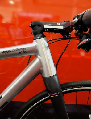 The oversized head tube and on this machine, a negative rise stem