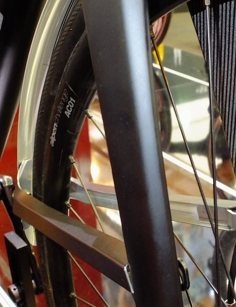 The front aluminium mudguard clips neatly in to place inside the fork legs