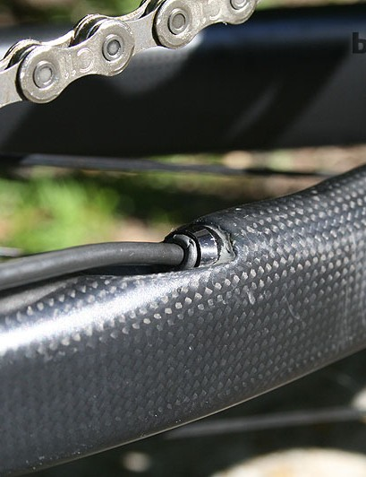 The electronic derailleur cable emerges from midway down the chunky chainstay