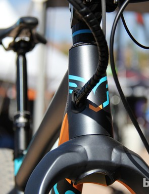 The Fat-E has internal cable routing through a port on the side of the head tube
