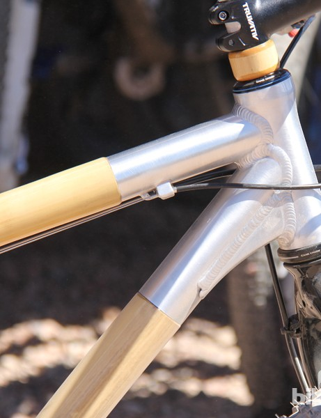 The bamboo main tubes are bonded to the aluminum front end