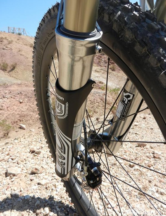 X-Fusion's carbon fork guards bolt neatly in place are are fully replaceable