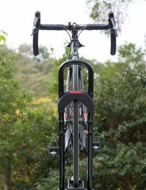 As you tighten the wheel tray, it pulls the bike inline and locks it in place