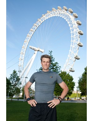James Cracknell, Duracell Power Me ambassador, stands in front of the London Eye
